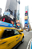 Times Square and Broadway and Taxi with motion blur, Manhattan, New York, USA