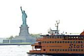 Statue of Liberty and Staten Island Ferry, New York, USA