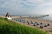 Beach with canopied beach chairs and pier, Baltic Sea, Seaside Resort of Koserow, Island of Usedom, Mecklenburg-Western Pomerania, Germany