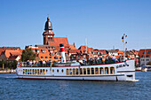 Excursion boat in front of church St. Mary, Waren at Mueritz lake, Mecklenburg lake district, Mecklenburg Western-Pomerania, Germany, Europe