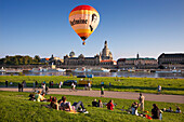 Balloons rising from the Elbe riverbank, Bruehlsche Terrasse and Frauenkirche in the background, Dresden, Saxonia, Germany, Europe