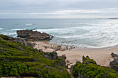 Beach and rocks under clouded sky, Brenton on rocks, Garden Route, South Africa