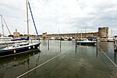 Sailing boats in marina, city wall in background, Aigues-Mortes, Gard, Languedoc-Roussillon, France