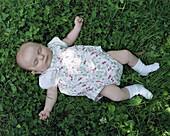 Baby sleeping on grass