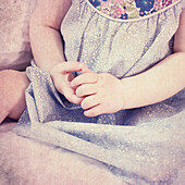 Baby girl's arms, cropped
