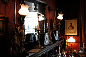 Candles and mirror on mantelpiece