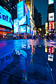 People at Times Square at night, Manhattan, New York, USA, America
