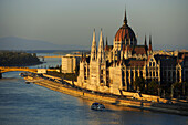House of Parliament at Danube river in the light of the evening sun, Budapest, Hungary, Europe