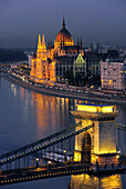 View of Danube river, Chain Bridge and House of Parliament at night, Budapest, Hungary, Europe