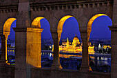 View from the Fisherman's Bastion onto the House of Parliament at Danube river at night, Budapest, Hungary, Europe