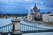 Danube river, House of Parliament and Chain Bridge at dusk, Budapest, Hungary, Europe