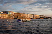 Sightseeing boat excursion on Neva river, St. Petersburg, Russia