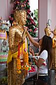 Woman worships at Phra Pathom Chedi, world's tallest Buddhist monument, Nakhon Pathom, Thailand