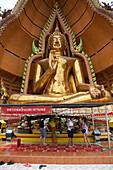 People in front of Giant Buddha, Wat Tham Khao Noi, Khao Noi Cave Temple, near Kanchanaburi, Thailand