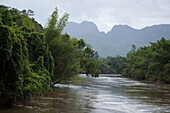 Lush jungle vegetation and mountains along River Kwai Noi, near Kanchanaburi, Thailand
