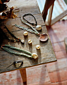Handmade jewellery on wooden table, La Passe, La Digue and Inner Islands, Republic of Seychelles, Indian Ocean