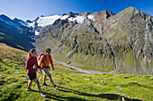 Young couple hiking in the mountains, Obergurgl, Oetztal Alps, Tyrol, Austria, Europe
