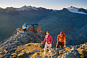 Young couple hiking in the mountains, Ramolhaus, Obergurgl, Oetztal Alps, Tyrol, Austria, Europe