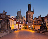 Charles bridge and city gate in the evening, Prague, Czechia, Europe