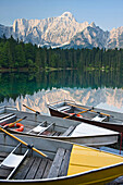 Rowing boats at the banks of Laghi di Fusine, Julian Alps, Italy, Europe