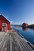 Huts along the coast in Loshamn harbour, Rogaland, Norway