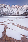 Snowy shores of lake Duerrensee in front of Monte Cristallo mountain, Alto Adige, South Tyrol, Italy, Europe