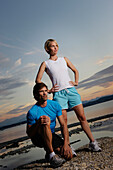 Couple wearing sports clothing at lake Starnberg, Bavaria, Germany