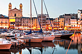 The old harbor, the old town and St Jean Baptiste at dusk, Bastia, Corsica, France