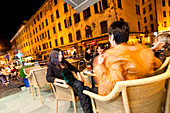 Ladies enjoying the evening in the Rex Lounge, old town, Cours Paoli, Corte, Corsica, France