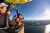 People on hot air balloon ride above lake Starnberger See, Upper Bavaria, Germany, Europe, Europe