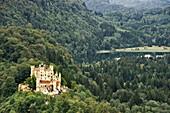 View to Hohenschwangau Castle and lake Schwansee in background, Schwangau, Allgau, Bavaria, Germany
