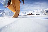 Skier running to the Schoenwies alpine hut, Obergurgl, Tyrol, Austria