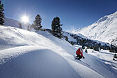 Skier sking in fresh new snow at hohen Mut, Obergurgl, Tyrol, Austria