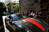 Sports car at the town of Radicofani, Tuscany, Italy, Europe