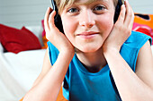 Portrait of a young boy wearing headphones