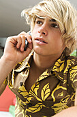 Portrait of teen boy using mobile phone