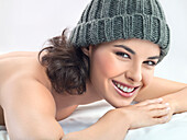Young woman with knit hat smiling for camera