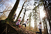 Children playing along the lakeshore, Leoni castle grounds, Leoni, Berg, Lake Starnberg, Bavaria, Germany