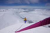 Mountaineer walking along the southwest edge of Moench, Grindelwald, Bernese Oberland, Switzerland