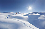 Young girl trudging through deep snow, Kloesterle, Arlberg, Tyrol, Austria