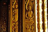 Reliefs with Buddhas at the windows, Wat Ho Pha Bang at the Royal Palace, Luang Prabang, Laos