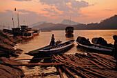 Boats at the banks of Mekong river, Luang Prabang after sunset, Laos