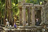 Tourist at the entrance to Preah Khan temple, Angkor, Cambodia, Asia