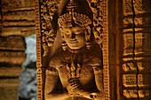 Stone relief of a deity inside Preah Khan, Angkor, Cambodia, Asia