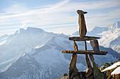 Cairn at Peterskoepfl with view towards Zillertal mountain range, Zillertal Alps, Zillertal, Tyrol, Austria