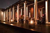 Guests enjoy dinner, The Beach Restaurant, The Chedi Muscat hotel, Muscat, Masqat, Oman, Arabian Peninsula