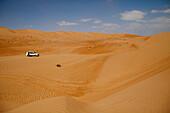 Muscat Desert Adventures 4WD vehicle during dune bashing tour, Wahiba Sands desert, Bidiya, Ash Sharqiyah, Oman, Arabian Peninsula