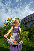 Girl harvesting carrots, Urban Gardening, Urban Farming, Stuttgart, Baden Wurttemberg, Germany