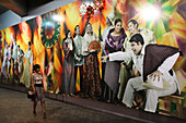 Young woman looking at a wail painting in a tunnel, Makati City, Manila, Luzon Island, Philippines