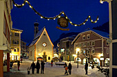 People in snowy street in the evening, Ortisei, Val Gardena, South Tyrol, Italy, Europe